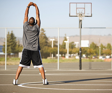 Man stretching on basketball court