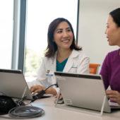 Doctors in meeting using computer