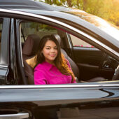 Woman sitting in a vehicle