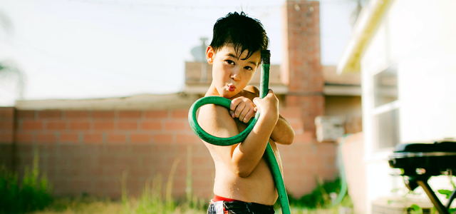 the boy with a hose