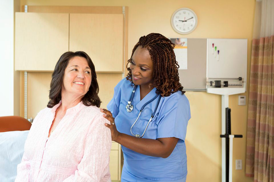 picture of a female medical provider and female patient