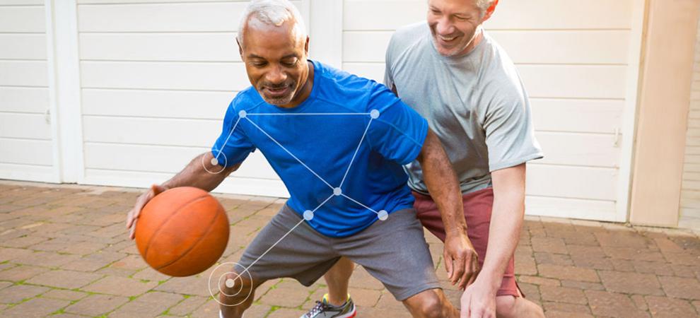 Two men playing basketball