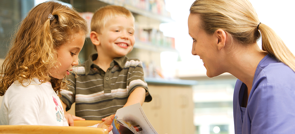 Pediatrics.two-children-doctor-woman-blonde