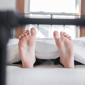 toes of a man in bed