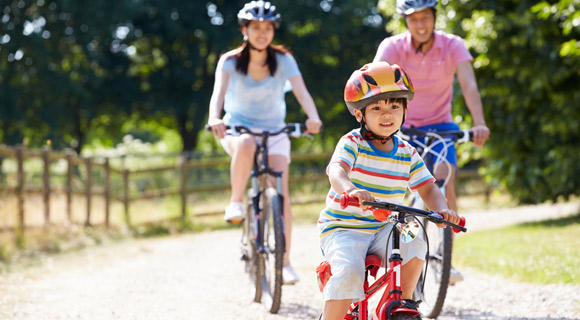 Family riding bikes to stay active