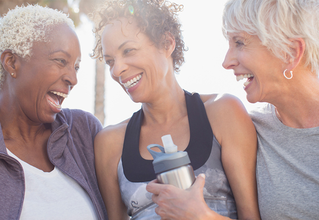 3 older women enjoying being active outdoors.