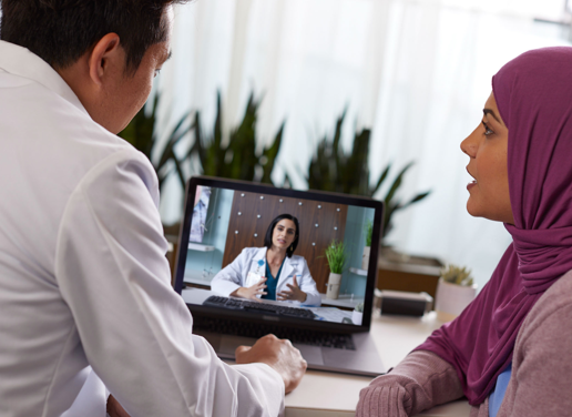 doctor and patient videochat with another doctor