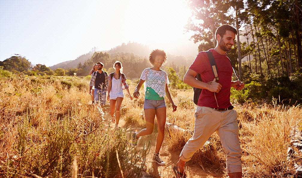 Group of young adults hiking.
