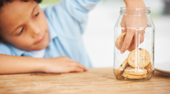 Child reaching into cookie jar