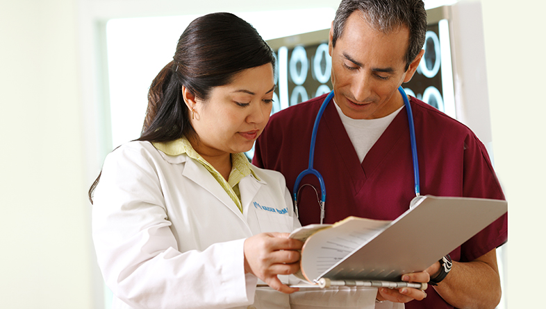 Kaiser Permanente care team review a patient's medical records.