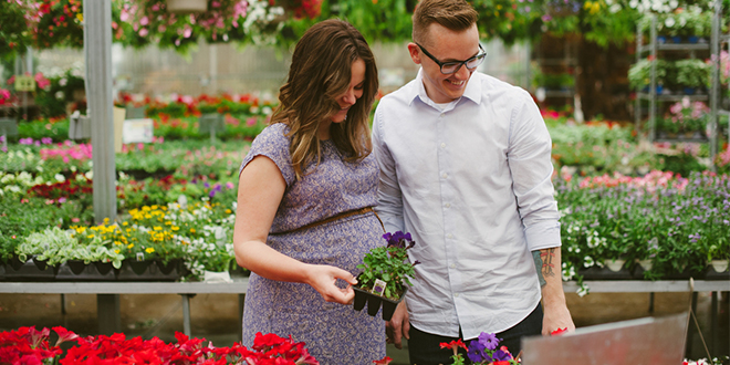 Couple buying plants at nursery.
