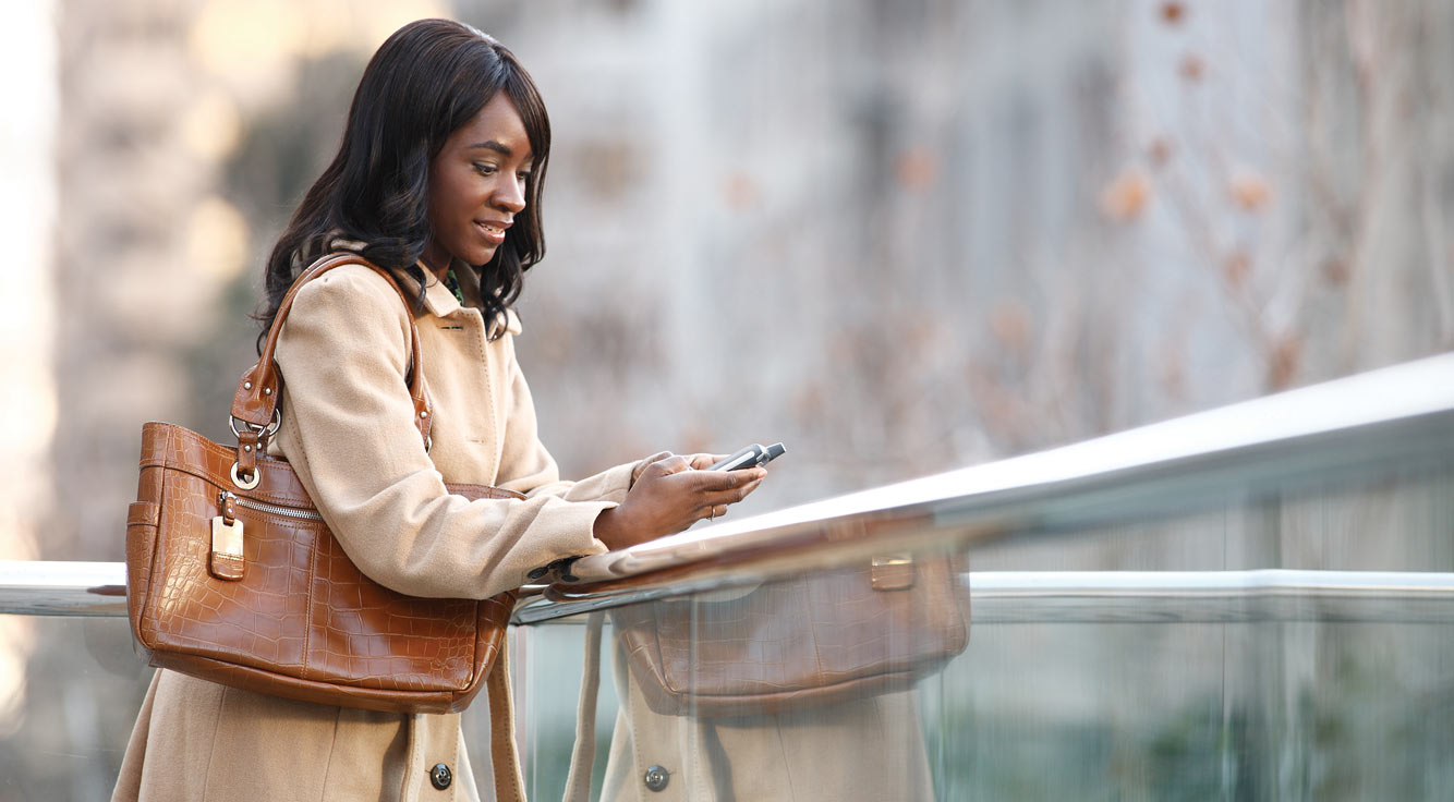 A woman uses a smartphone.