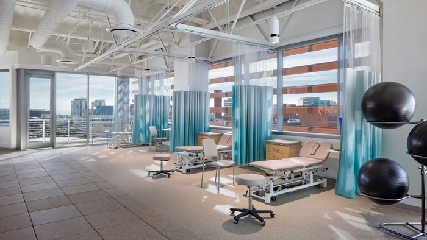 Bright airy rehabilitation treatment spaces with floor to ceiling windows and a balcony