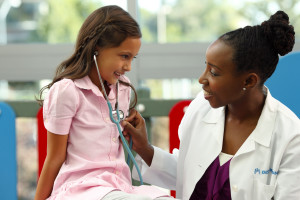 Doctor and girl with stethoscope