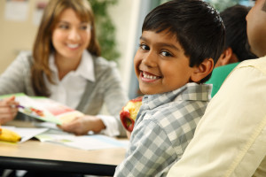 Smiling kid with nutritionist